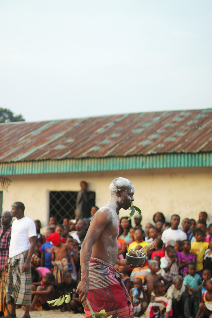 Wrestler covered in white powder, Ete Wrestling Festival, Isiokpo