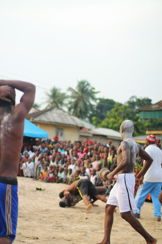 A wrestler throwing another wrestler to the ground, Ete Wrestling Festival, Isiokpo