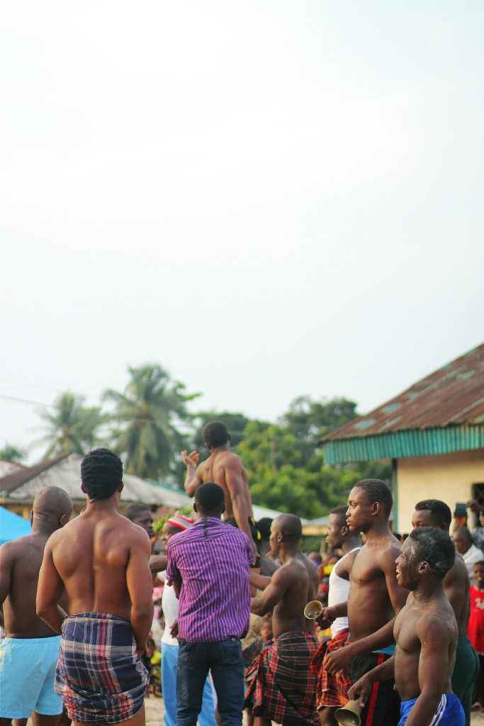 A wrestler being carried by his peers after his victory in a wrestling bout, Ete Wrestling Festival, Isiokpo