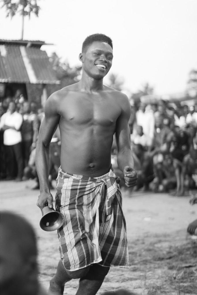 Wrestler ringing a bell, Ete Wrestling Festival, Isiokpo