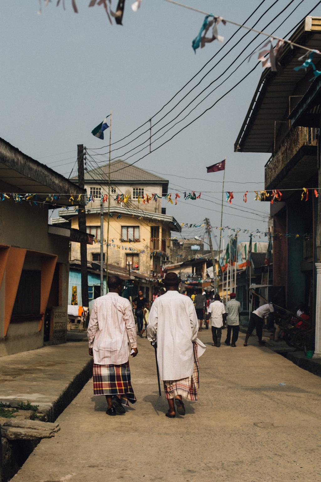 Two men walking in Opobo