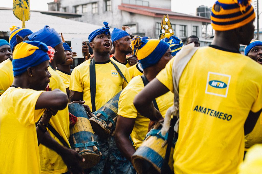 Men wearing MTN's yellow, Opobo Boat Regatta