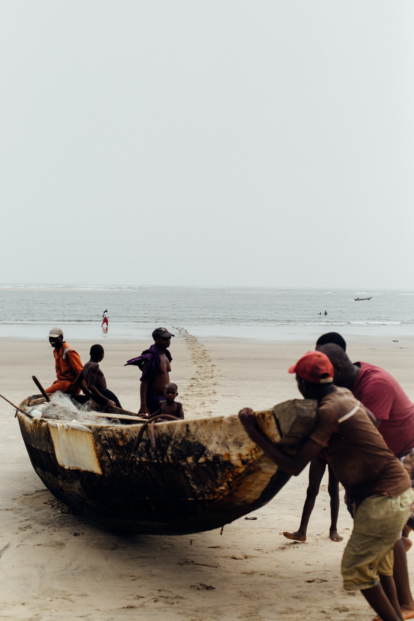 Fishermen bringing the boat home, Ibeno Beach