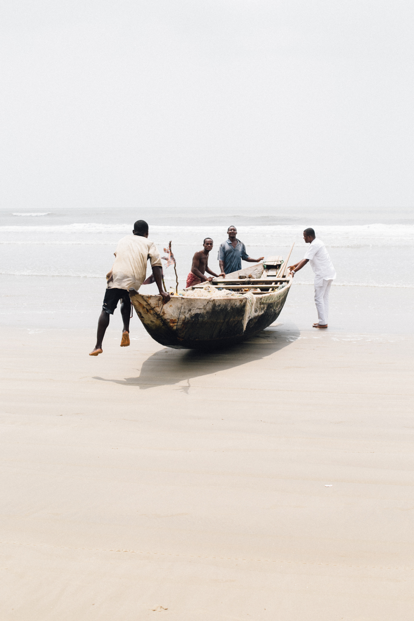 Fishermen bringing the boat home, Ikuru Town Beach