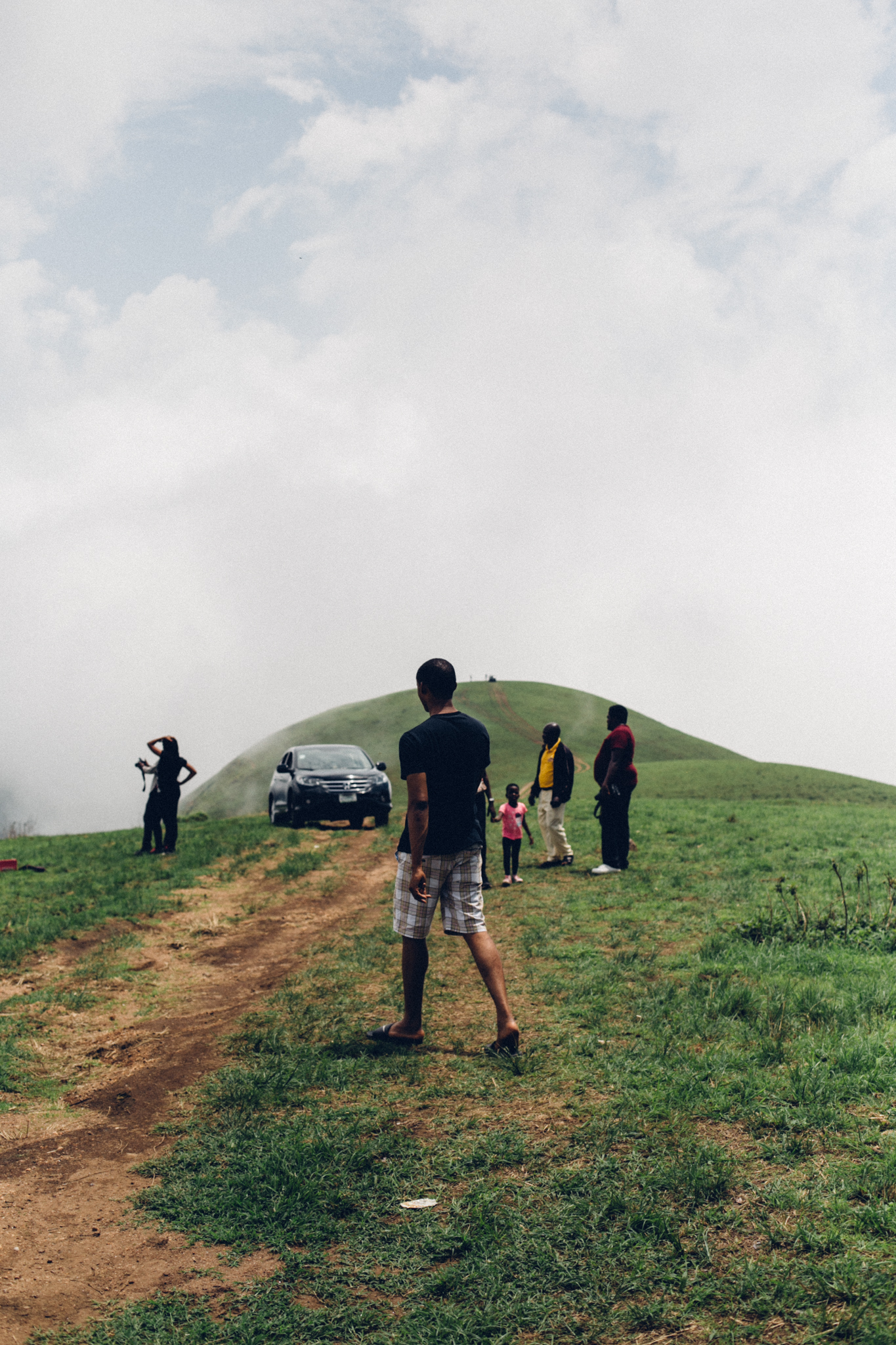 People on a hill top, Obudu