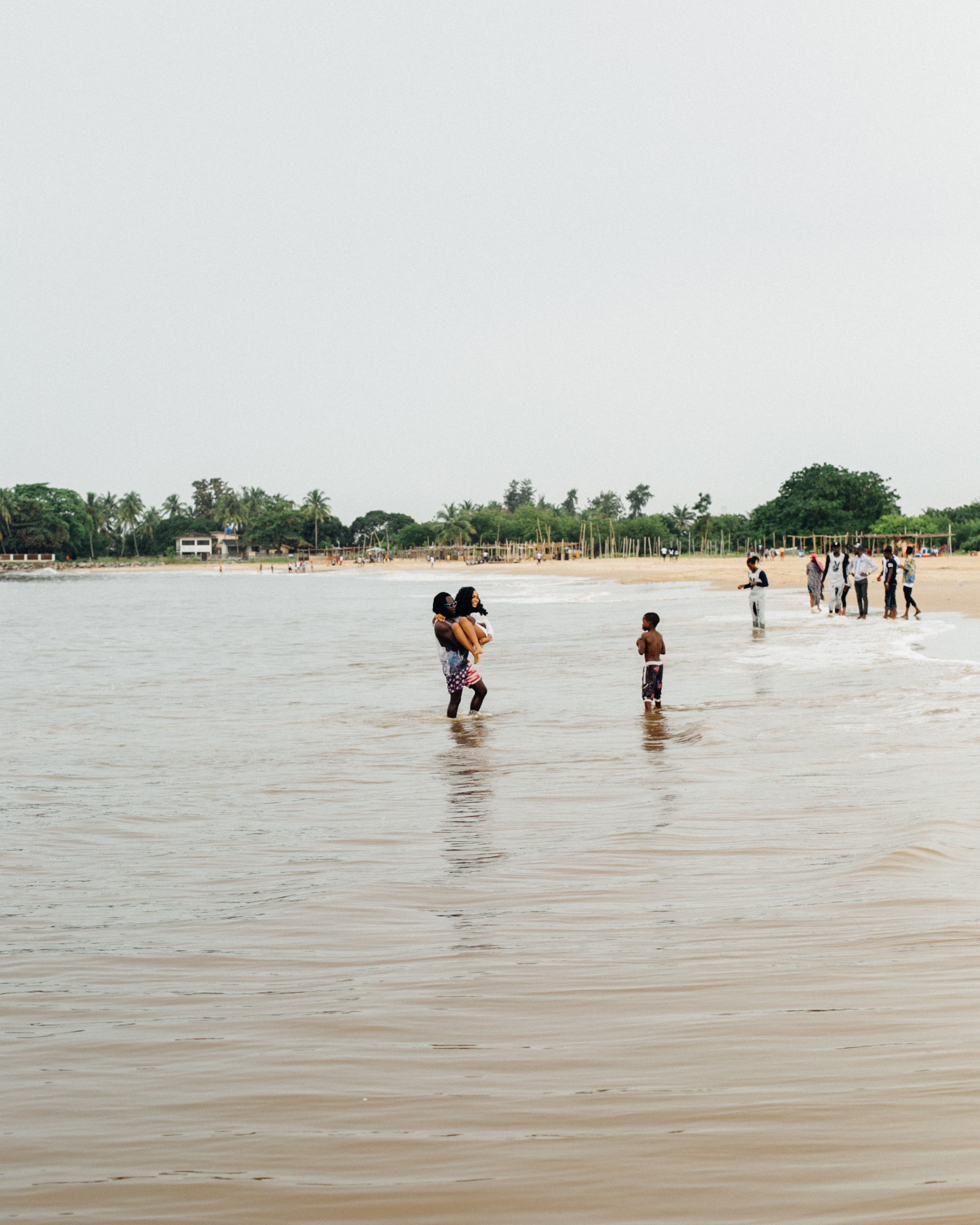 Lady being carried from the boat to the beach, Tarkwa bay