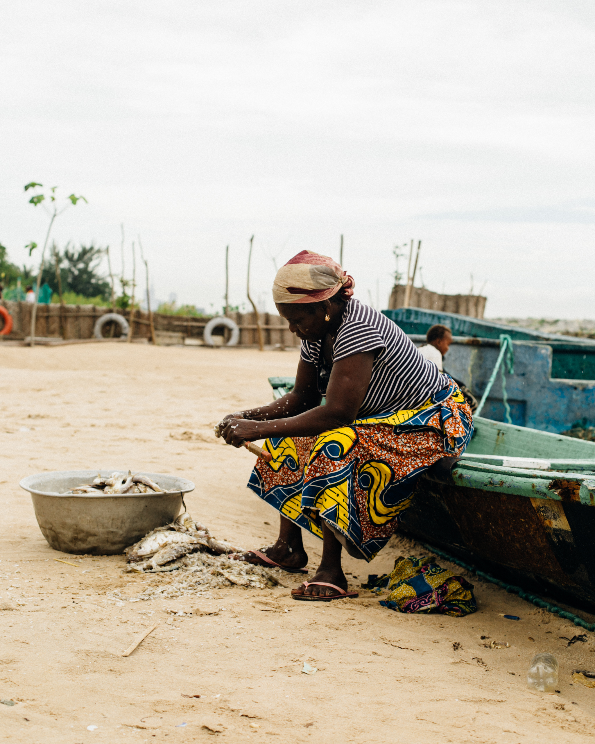 Woman cleaning fish, Tarkwa Bay