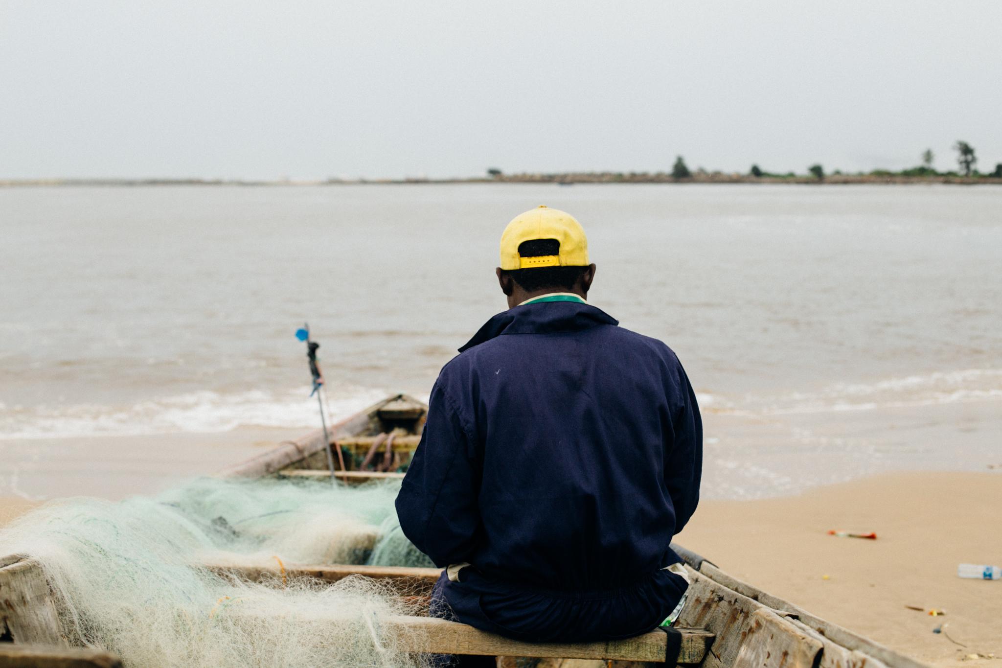 Fishermen mending fishing nets