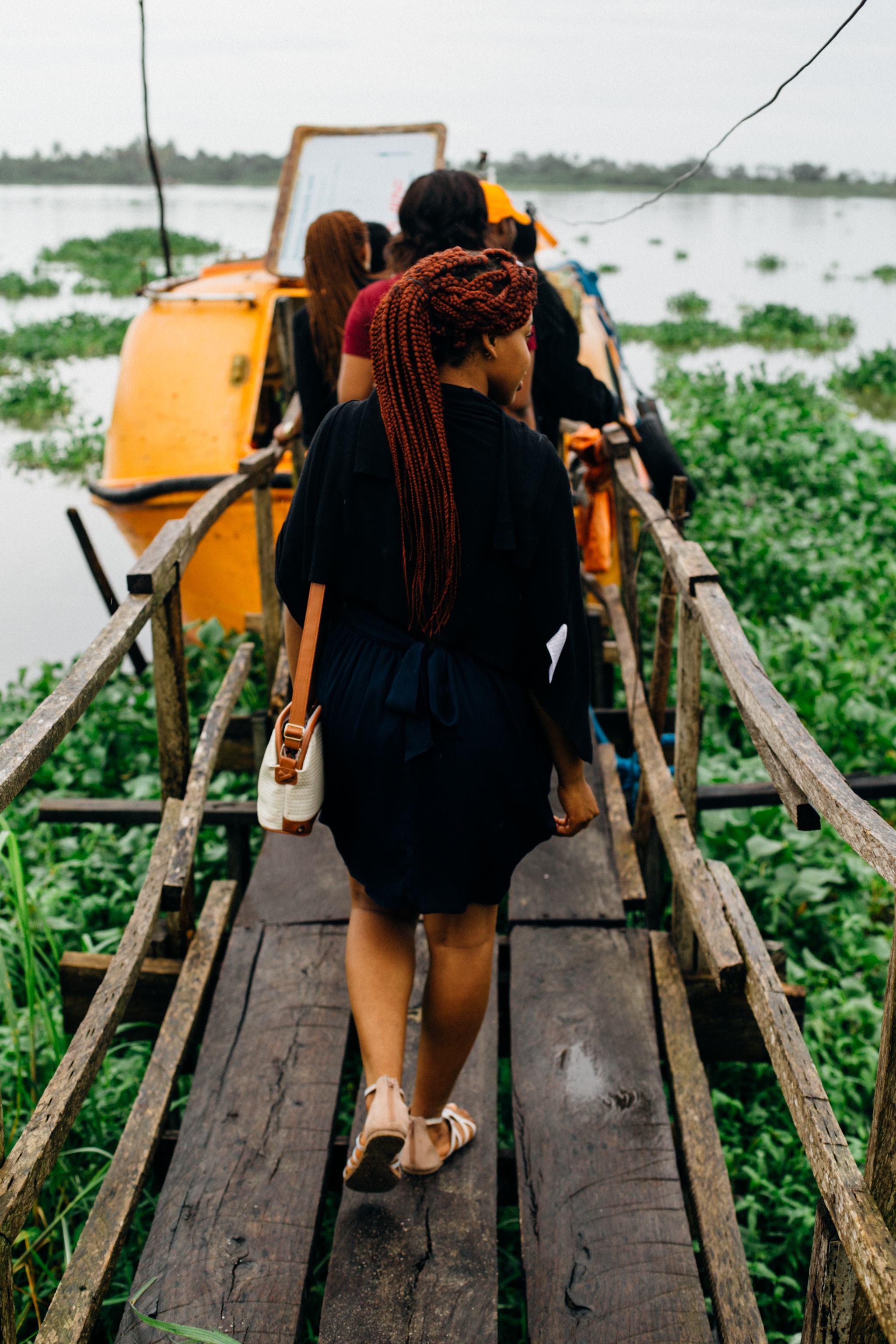 Tourists walking into the Orange Boat, Marina, Badagry