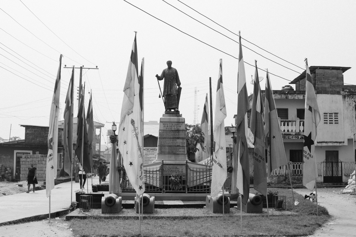 Statue of King Jaja of Opobo showing the flags of the different Compounds or Houses