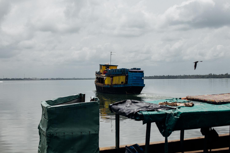 House boat leaving the floating market in Koko, Niger Delta