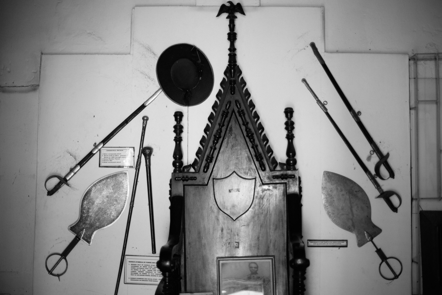 Nanna's Seat with staff and swords he got as gifts hanging on the wall
