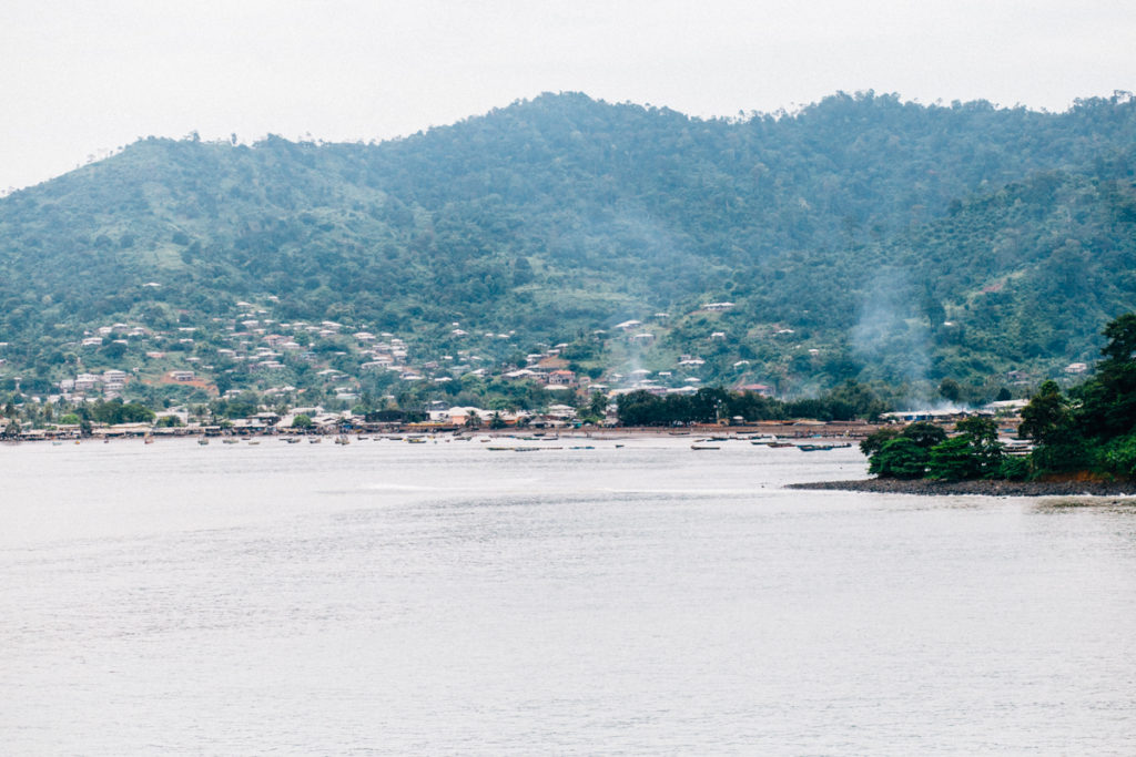 Beach with houses on hills in the background, Limbe
