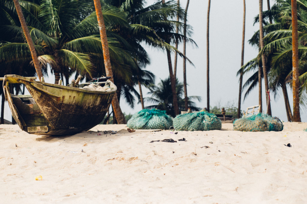 Canoe and fishing nets on the beach, Folu